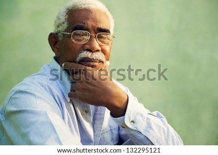 Black people and emotions, portrait of depressed senior man with glasses looking at camera. Copy space - stock photo