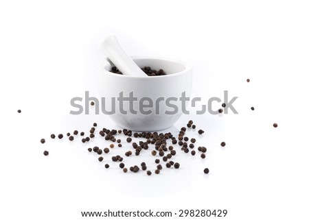 Black peper peppercorns in mortar and pestle - stock photo