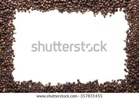 Black pepper and white frame in the center - stock photo