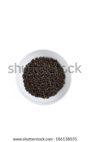 black pepper in on white cup in studio light - stock photo