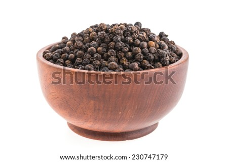 Black pepper in wooden bowl isolated on white background - stock photo