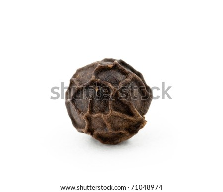 Black peppercorn against a white background