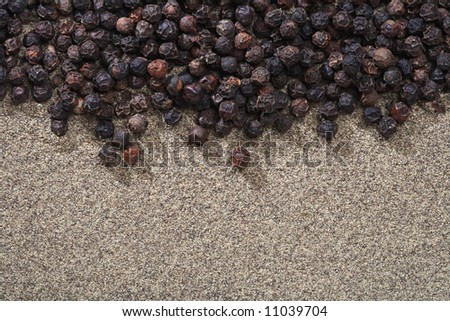 black peppers whole and ground on background, macro shot - stock photo