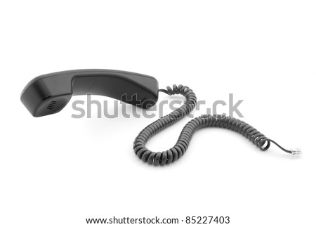 Black phone handset with soft shadow on white