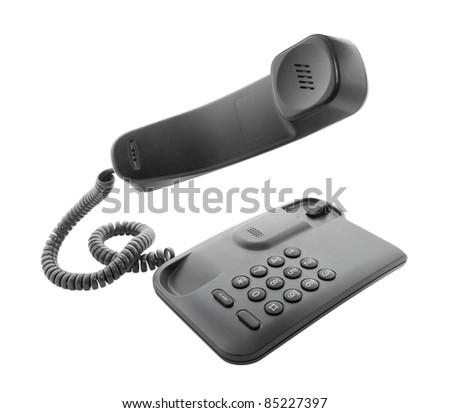 Black phone with floating handset - stock photo