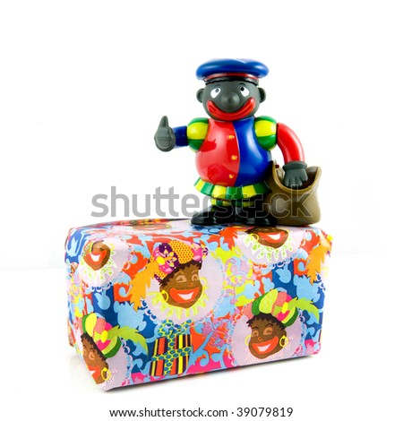 Black piet with present isolated on white background - stock photo