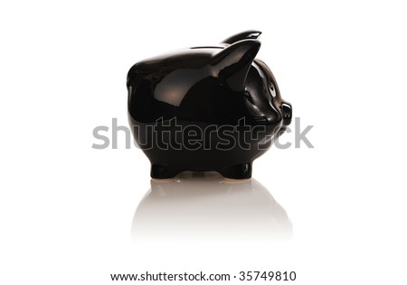 Black piggy bank isolated on white with soft reflection and shadow