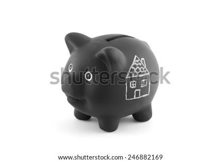 Black piggy bank with drawing of house. Clipping path included. - stock photo