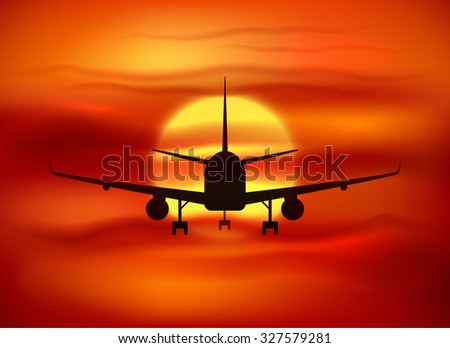 Black plane silhouette at red sunset background - stock photo