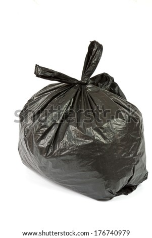 Black plastic bag from recycled plastic waste - stock photo