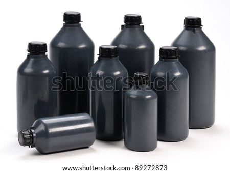 Black plastic bottles - stock photo