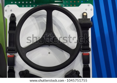 Black plastic wheel and a pair of safety belts