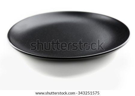 Black plate isolated on white background - stock photo