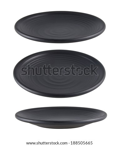 Black plate isolated on white background with different angle of view - stock photo
