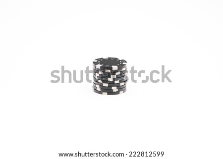 Black poker chips isolated on white background - stock photo