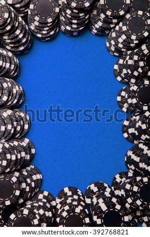 Black poker chips on red felt with copy space