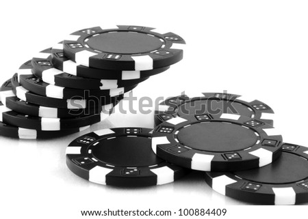 black poker chips on white background
