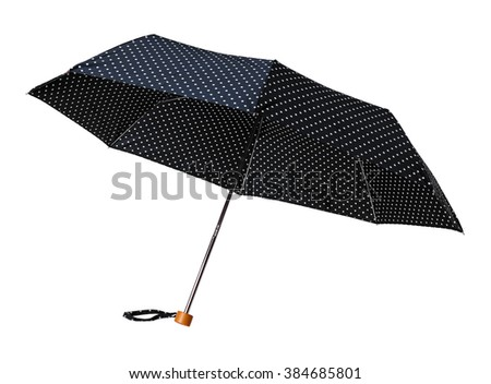 Black polka dot umbrella outdoor isolated on white background - stock photo