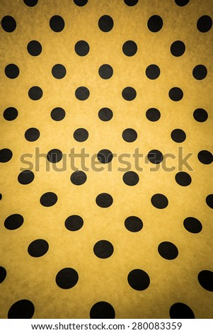 black polka dots on brown paper background - stock photo