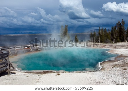 Black Pool hot spring in West Thumb Geyser Basin. Yellowstone National Park. - stock photo