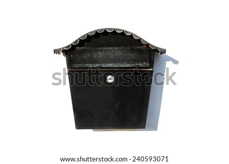 Black post letter box with key hole on the white wall. Mailbox - stock photo