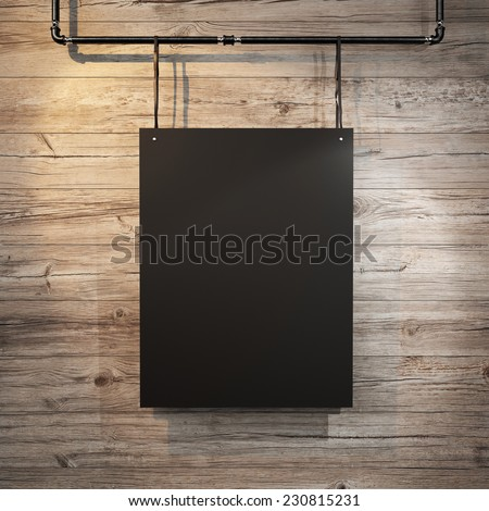Black poster hanging on leather belt on wood background - stock photo