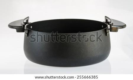 black pot on white - stock photo