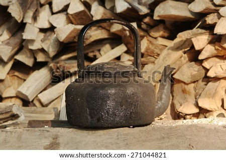 black pot with fire wood background - stock photo