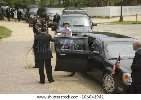 Black Presidential Limo's door opening for Her Majesty Queen Elizabeth II after pulling up in front of Governor's Palace in Williamsburg, Virginia on May 4, 2007. - stock photo