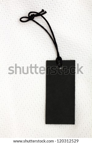 black price tag over white tissue - stock photo