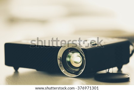 Black projector on light table, close up - stock photo