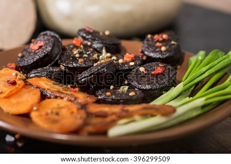 black pudding sausage  with vegetables - stock photo