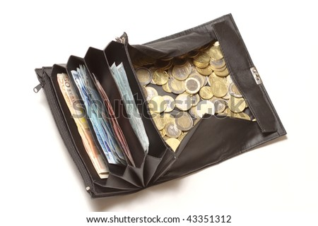Black purse, as used by waiters or taxi drivers, with lots of 1 and 2 Euro coins and 5, 10, 20 and 50 Euro bills. - stock photo