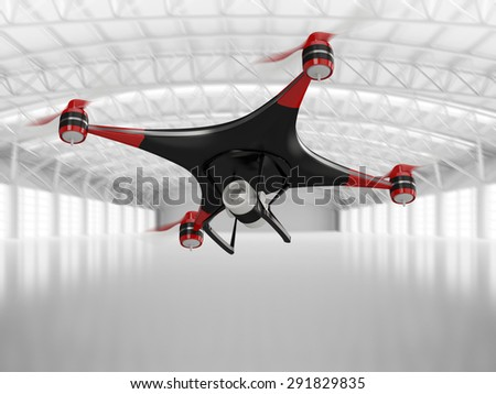 black quadcopter drone with HD camera in flight in interior warehouse - stock photo