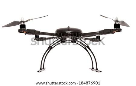 Black quadrocopter at studio - stock photo
