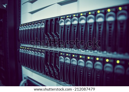 Black rack mounted server tower in large data center - stock photo