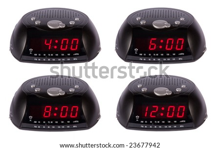 Black radio alarm clock showing four different times - stock photo