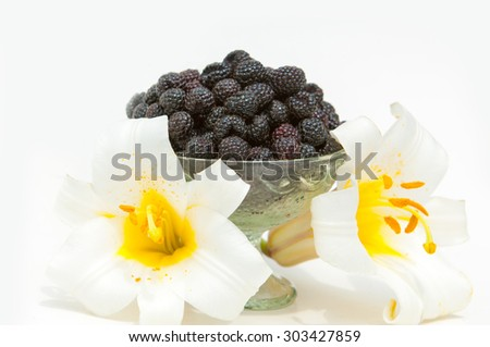 black raspberries. an edible soft fruit related to the blackberry, consisting of a cluster of black drupelets. - stock photo