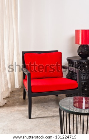 Black red Chair and side table in a bright setting