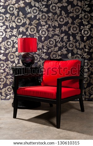 Black red Chair furniture with elegant wall decoration - stock photo