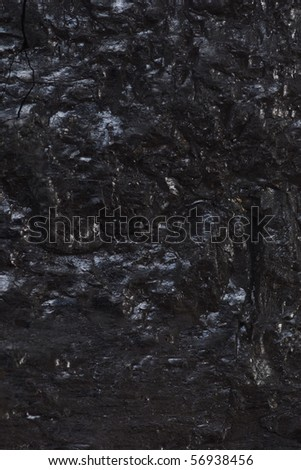 Black reflective coal textured background - stock photo