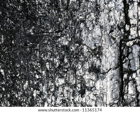 Black reflective surface of coal with chips and cracks - stock photo