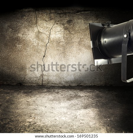 black retro lamp and dirty wall  - stock photo