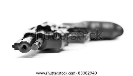 Black revolver gun with little depth of field. Isolated on white background - stock photo
