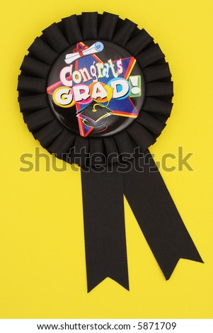Black ribbon award for Graduate on yellow background - stock photo