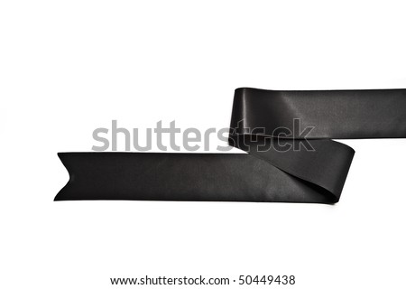 Black ribbon, symbol of grief, isolated on white. - stock photo