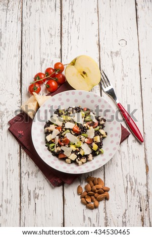black rice salad with tomatoes apple almond and parmesan cheese - stock photo