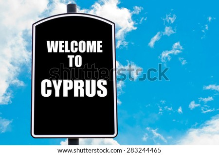 Black road sign with greeting message WELCOME TO CYPRUS isolated over clear blue sky background with available copy space. Travel destination concept  image