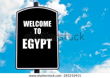 Black road sign with greeting message WELCOME TO EGYPT isolated over clear blue sky background with available copy space. Travel destination concept  image