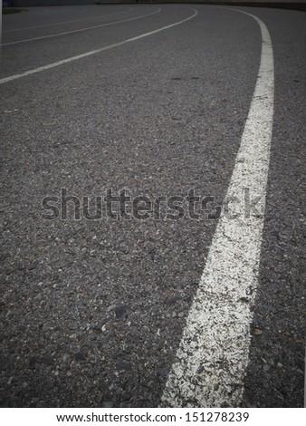 Black road texture with a white stripe - stock photo